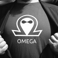Nico Grienauer is opening his jacket to reveal a omega t-shirt